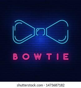 Neon lights men's bowtie. Bright advertising bowtie on the shirt. Modern vector logo, banner, shield, bowtie pattern . Night advertising on the background of a brick wall.