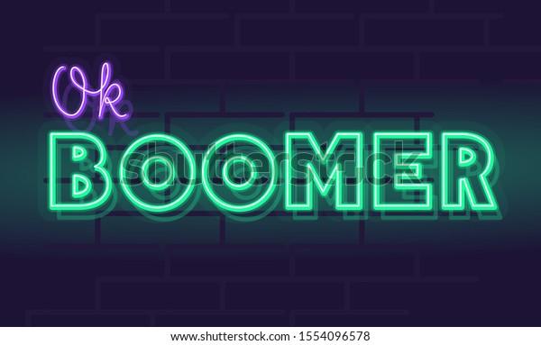 Neon ok boomer la typographie manuscrite audacieuse. Citation isolée sur fond flou de brique.