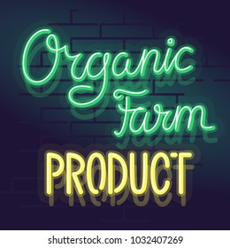 Neon organic farm product label for package, poster or web site. Isolated bright glowing handwritten text on brick wall background.