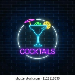 Neon sambuca cocktail sign in circle frame on dark brick wall background. Glowing gas advertising with glass of alcohol shake. Drinking canteen banner. Night club invitation. Vector illustration.