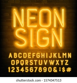 Neon Sign alphabet font. Yellow neon letters and numbers. Brick wall background. Stock vector typescript for your typography design.