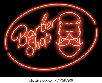 Neon sign barber shop. Red neon sign.A man's face with a beard and mustache with glasses in an oval frame on a black background. Vector illustration.