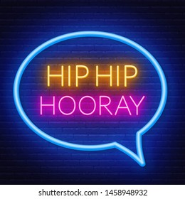 Neon sign hip hip hooray in frame on dark background. Light banner on the wall background.