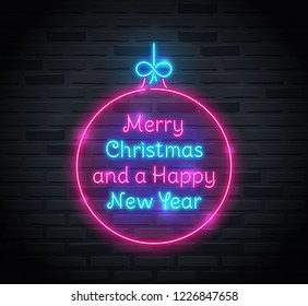 Neon sign of 'Merry Christmas and a Happy New Year' text inside of christmas ball