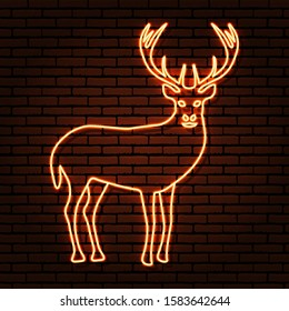 Neon sign. Wild deer outline in orange tones. With her head turned, the front view. Against a brick wall, with a shadow.