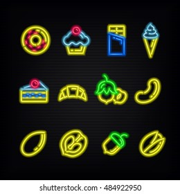 Neon signs. The symbols of desserts sweets and different nuts on a dark background.