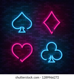 Neon Suit Poker and Casino on brick wall. Vector illustration.