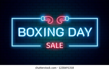 Neon text Boxing Day sale on brick wall background for advertising or promotion concept.