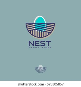 Nest  logo. Family store logo. Nest with an egg on a blue background.