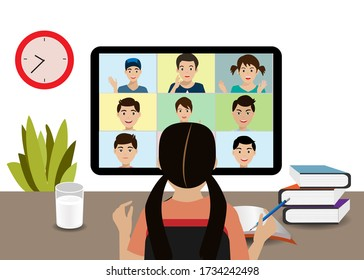 New normal of school during COVID-19 pandemic. Children at home online studying with classmate via video/web conferance on computer during city quarantine to prevent COVID-19 corona virus.