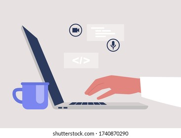 New technologies, a side view of an open laptop, millennials at work, a startup industry