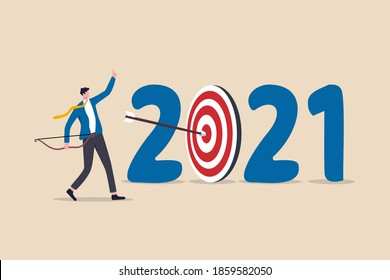 New year 2021 resolution, business strategy plan and goal achievement, financial target for calendar year concept, confidence businessman leader shot archer arrow hitting bull eyes of target year 2021