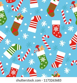 New Year`s vector seamless background with Christmas socks, candy, gifts and snowflakes