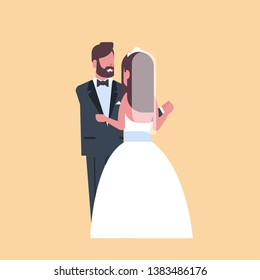 newlyweds just married man woman embracing dancing together romantic couple bride and groom in love wedding day concept yellow background full length flat