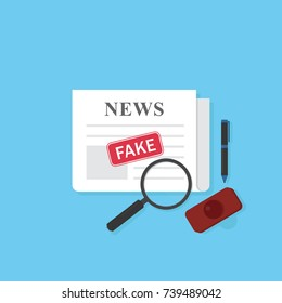 Newspaper with fake news stamp and stationary. Hoax concept