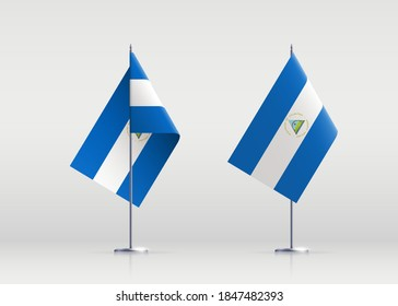 Nicaragua flag state symbol isolated on background national banner. Greeting card National Independence Day of the Republic of Nicaragua. Illustration banner with realistic state flag.