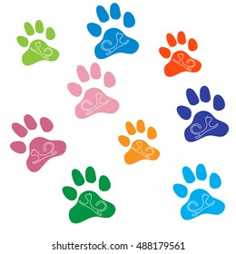 Nice picture of silhouette cats lying inside multicolored animal traces on a white background.