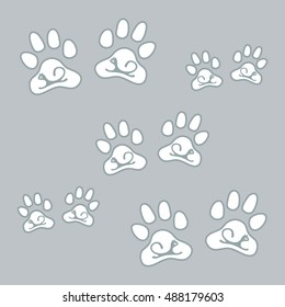 Nice picture of silhouette cats lying inside animal traces on a colored background in gentle tones.