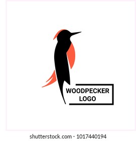 Nice two colors logotype of bird. Cute woodpecker with red and black body, logo on the white background. Simple design of vector illustration.