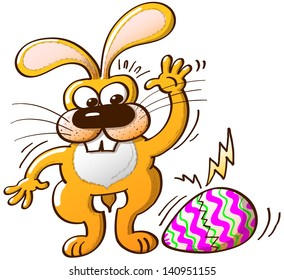 Nice yellow bunny surprisingly noticing how his Easter egg, he has just painted, begins to break