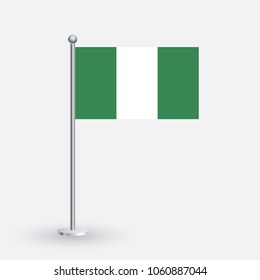 Nigeria flag. The national flag of Nigeria on a pole. The waving flag. The sign and symbol of the country. Realistic vector on white.