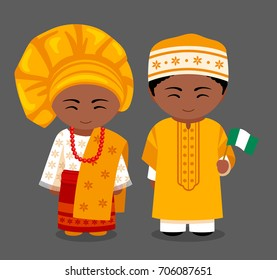 Nigerians in national clothes with a flag. Man and woman in traditional costume. Travel to Nigeria. People. Vector flat illustration.