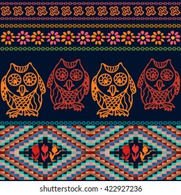 Night owls. Bohemian seamless pattern. Gypsy and Peruvian motifs. Blooming flowers, pagan owls, doodle prints, geometric triangles border. Folk art textile collection. Dark blue, red, golden.