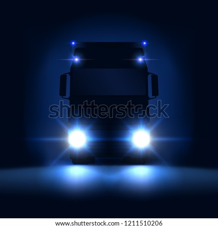 c0018093c3 Night silhouette big semi truck with bright headlights and semi riding on  the dark night background