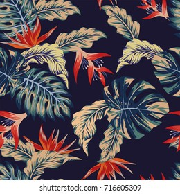 Night tropical jungle print seamless pattern leaves and flowers on the dark blue background