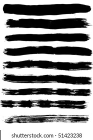 Nine black silhouettes of traces of brush on white background