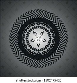 ninja star icon inside black emblem