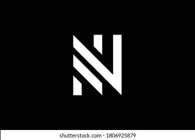 NN letter logo design on luxury background. NN monogram initials letter logo concept. NN icon design. Elegant and Professional white color letter icon design on black background. NN
