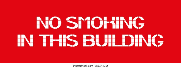 No Smoking In This Building White letters on a red background in the box, a warning character.