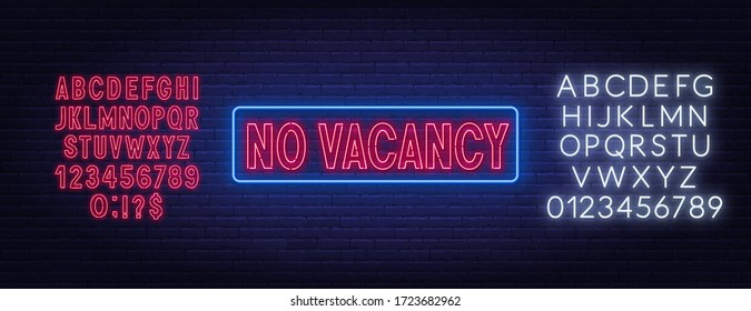 No vacancy neon sign on brick wall background.