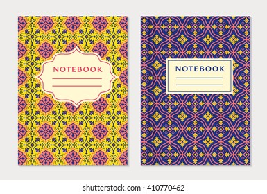 Notebook cover designs. Two exercise books with abstract yellow, purple and pink pattern and place for text. Oriental style collection. Vector set.
