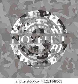 Novelist written on a grey camouflage texture