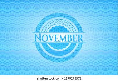 November light blue water wave emblem.