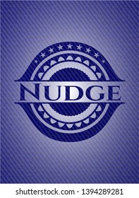 Nudge emblem with denim high quality background. Vector Illustration. Detailed.