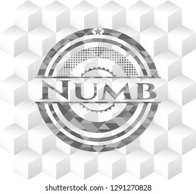 Numb grey badge with geometric cube white background
