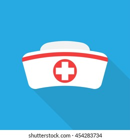 Nurse hat with cross isolated on blue background. Flat icon. Nurse hat closeup