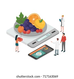 Nutritionists planning a diet using a food measuring scale and a food app on the smartphone, diet and nutrition concept