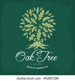 Oak tree handmade shabby logo design concept on green background. Web graphics modern vector sign. Vintage quality organic goods co. illustration.