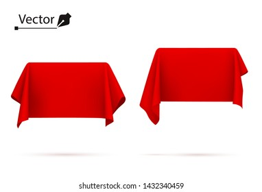 Object covered with red silk cloth. Box, rectangle. Surprise, award, prize, presentation concept. Reveal a hidden object.