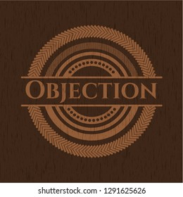 Objection badge with wooden background
