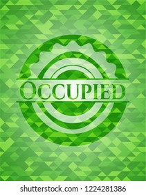 Occupied green emblem with mosaic background