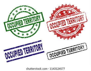OCCUPIED TERRITORY seal prints with damaged texture. Black, green,red,blue vector rubber prints of OCCUPIED TERRITORY label with dirty texture. Rubber seals with circle, rectangle, medal shapes.