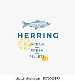 Ocean Fresh Fillets Abstract Vector Sign, Symbol or Logo Template. Hand Drawn Herring Fish with Premium Modern Typography, Quality Seal and Tin Can Silhouette. Stylish Vector Emblem Concept. Isolated.