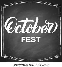 Octoberfest hand lettering on black chalkboard background. Vector illustration.