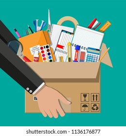 Office accessories in cardboard box in hand. Book, notebook, ruler, knife, folder, pencil, pen, calculator scissors tape file. Office supply stationery and education. Vector illustration flat style