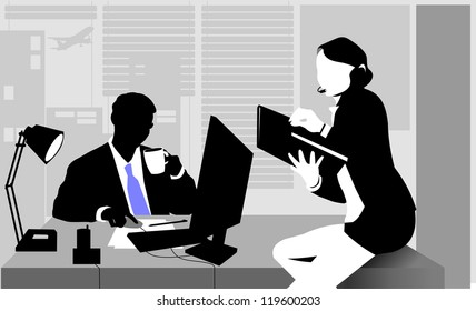 Office workers sitting at the table and working on computers;